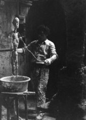 Giacometti working with plaster in his Paris studio in 1959, photographed by Isaku Yanaihara