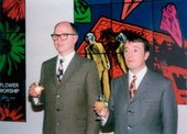 Gilbert & George raise a glass in the gallery