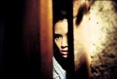 A girl peeks through a doorway