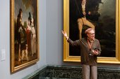 Tate guide gesturing towards a painting.