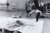 Otsuji Kiyoji documents Shimamoto Shōzō throwing glass bottles of colourful pigments against a stone at the centre of a canvas, 2nd Gutai Exhibition, Tokyo, 1956