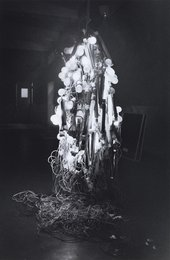Otsuji Kiyoji's photograph shows Tanaka Atsuko wearing her Electric Dress, made from electrical wires and painted neon light bulbs, at the 2nd Gutai Exhibition, Tokyo, 1956