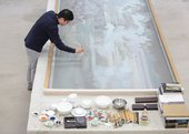 Hao Liang painting in his studio