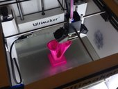 Photograph showing 3D printer printing a sculpture