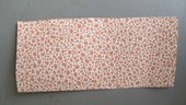 A sample of wallpaper from Belshazzar's Feast, white with orange irregular spots