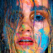 Close-up photo of girl with glitter on face
