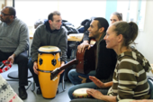 a group of people playing music and talking