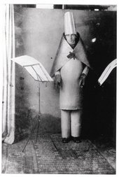 Hugo Ball reciting Karawane in a cubist costume at the Cabaret Voltaire, Zürich 1916