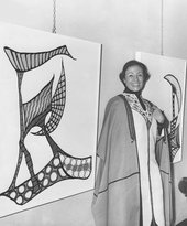 Huguette Caland wearing one of her signature kaftans in her first solo exhibition at Dar El Fan, Beirut, 1970