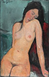 a woman sits on a chair nude