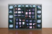 stacked grid of tvs against a white wall