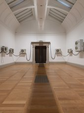 photo of a gallery room with air conditioning units arranged along the walls