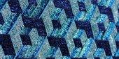 3D-effect geometric glittery pattern in blue hues