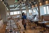 A photograph of a waitress at Tate Modern's restaurant