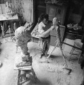 "Giacometti working on the plaster sculpture for ""L'homme qui marche"" (""The Walking Man""), 1958"