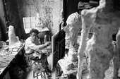 Giacometti in his studio painting