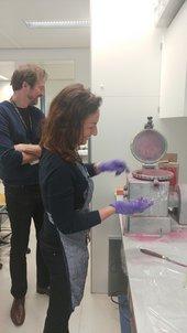 Klaas Jan van den Berg and Aviva Burnstock making paint using the paint mill