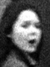 Photographic enlargement of the face of the girl from John Smith's The Girl Chewing Gum 1976
