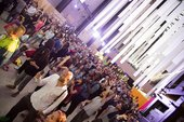 A large group of people enjoying a festival in the Turbine Hall