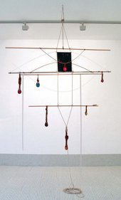 Anthea Hamilton Untitled Odile 2006 cross between a childs mobile and a torturous gym apparatus structured by horizontal bars between rope objects like billiard balls are suspended from the bars