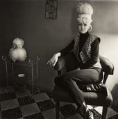 Diane Arbus, Lady Bartender at Home with a Souvenir Dog, New Orleans L.A. 1964,