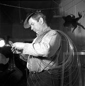 Herbert Matter, Alexander Calder in his studio, with wire