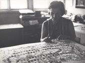 Běla Kolářová working on an assemblage with paper clips, photographed by André Villers, 1969