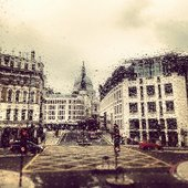A view of St Paul's through the rained-on window of a bus
