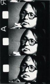 Photographic portrait of Toshio Matsumoto multiplied three times on a roll of film