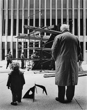 Alexander Calder installing Le Guichet 1963 with grandson Alexander S. C. Rower, Lincoln Center, New York, photographed by Bob Serating, 1965