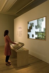 View of squaring up activity in a gallery of Constable: The Great Landscapes exhibition