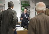 Dr Martin Kenig talking to Members and Patron in Tate Britain's Hyman Kreitman Reading Rooms, facing the camera