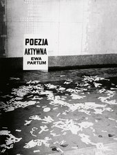 Ewa Partum Active Poetry 1971 photograph of a performance there are white paper letters of the alphabet strewn across the floor