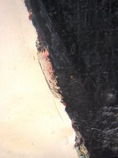 Detail of left edge of ball, showing glimpses of red and pink paint