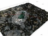 High-resolution 3D view of a deep green transparent pigment particle pushing through the black reticulated paint