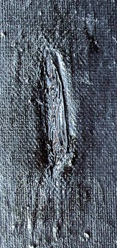 Detail of tear in leg filled with black paint