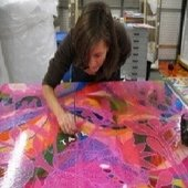 Conservator Natasha Walker applying the Tate logo in oil paint dots to the full-scale mock-up of Mono Rosa (Pink Monkey) to distinguish it from the original