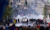 Seattle police use gas to push back World Trade Organization protesters in downtown Seattle on November 30, 1999