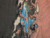 Micrograph of incised line around head of left figure, showing blue paint in underlying layers