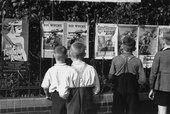 Julien Bryan, A group of young German boys view Der Stuermer, Die Woche and other propaganda posters that are posted on a fence in Berlin, 1937