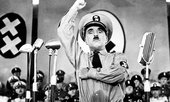 Charlie Chaplin as Hitler in The Great Dictator (1940) (film still)