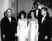 President John F. Kennedy and French Minister of Culture André Malraux arriving at the White House with their wives for a dinner held in honour of Malraux, 11 May 1962