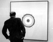 Clement Greenberg looking at Kenneth Noland's 1960 painting Nieuport, c.1974
