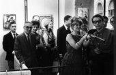 A visitor shooting at Niki de Saint Phalle's Feu à Volonté exhibition, Galerie J, Paris 1961