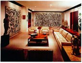 Photograph of the Hellers' lounge taken in 1960, showing (from left to right) Pollock, Echo: Number 25 1951; Rothko, Four Darks in Red 1958; Pollock, One: Number 31 1950; and Newman's Adam