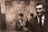 Bernard Perlin in front of Orthodox Boys 1948 at the opening of his first one-man show at M. Knoedler & Co., New York, 1948