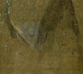 A triangle of lighter paint on a darker surface where the varnish has been removed from the painting