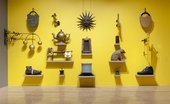 Items hanging on the wall for British Folk Art exhibition at Tate Britain