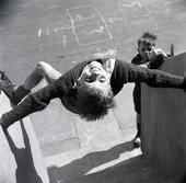 photograph of two boys in a playground, from about 1953