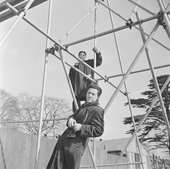 Photograph of Eduardo Paolozzi and unidentified man on scaffolding by Nigel henderson
